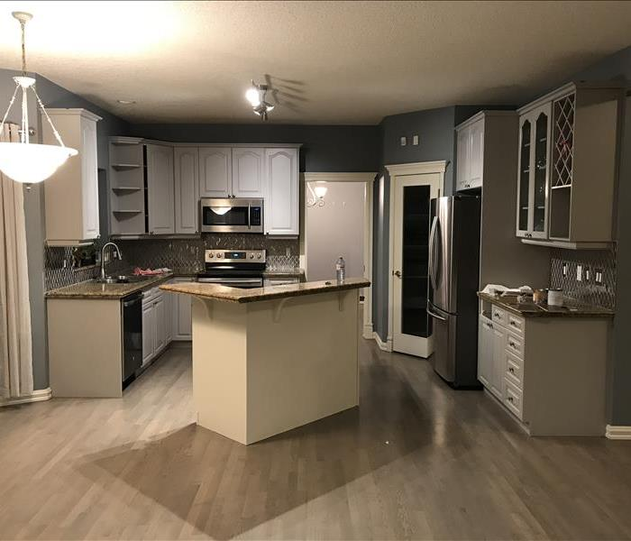clean hardwood in kitchen with island