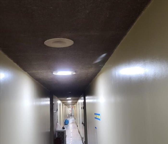 Fire and soot damage on the ceiling in the condominium hallways- Before Photo