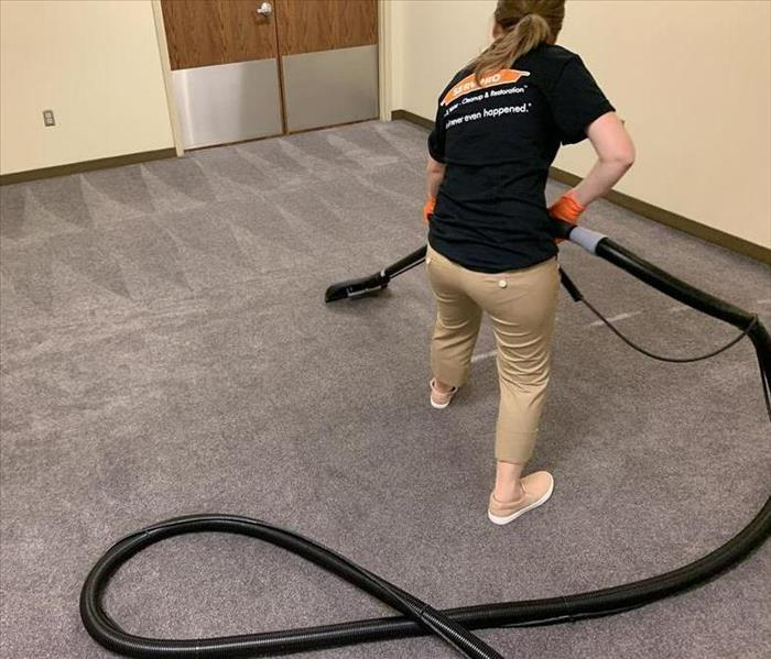 Crew member cleaning the carpet